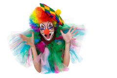 Girl in cap and clown costume with a bouquet of flowers puts out the tongue looks up Royalty Free Stock Photo