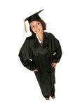 Girl in cap and gown. Graduate in cap and gown standing on white background Stock Image