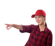Girl in a cap indicates hand Royalty Free Stock Photography