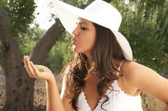Girl with cap kiss Royalty Free Stock Images