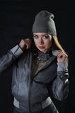 Girl in a cap and a leather skirt Royalty Free Stock Photography