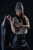 Girl in a cap and a leather skirt Stock Image