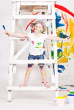 Girl in a cap with paints Stock Photography