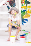 Girl in a cap with paints. Girl in a cap soiled by bright paints Stock Images