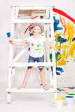Girl in a cap with paints Stock Image