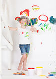 Girl in a cap with paints Royalty Free Stock Image