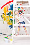 Girl in a cap with paints Royalty Free Stock Photo