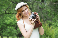 Girl in cap photographer Stock Photography