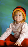 Girl in a cap rastafarian Royalty Free Stock Image