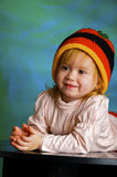Girl in a cap rastafarian Stock Photography
