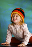 Girl in a cap rastafarian Stock Images