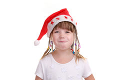 The girl in a cap of Santa Claus. The girl in a cap of the wizard on a white background Royalty Free Stock Images