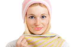 Girl in cap and scarf Stock Images