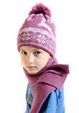 The girl in a cap and a scarf Royalty Free Stock Photography