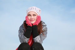 Girl in cap squatting and holds hands on cheeks Royalty Free Stock Images
