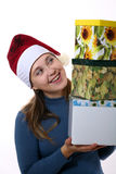 Girl in a cap with three boxes Royalty Free Stock Images