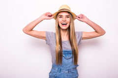 Girl in cap on white. Summer holiday mood Stock Image