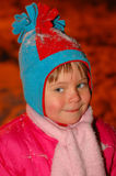 The girl in a cap in the winter. The smiling girl in a cap in the winter royalty free stock photo