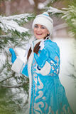 Girl in a cap in the winter in the wood Stock Photography