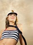 Girl in captain's hat stock photo
