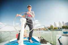 Girl captain of the yacht Stock Photo