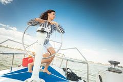 Girl captain of the yacht Stock Image