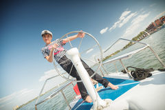 Girl captain of the yacht Royalty Free Stock Images