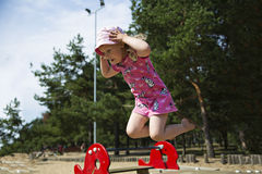 Girl captured on camera while jumping Royalty Free Stock Photography