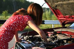 Girl with car 1 Royalty Free Stock Photo