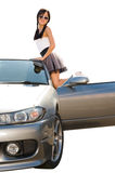 Girl by car. Young asian girl standing at car footboard royalty free stock photo