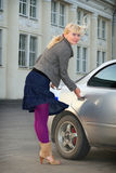 Girl beside car Royalty Free Stock Images