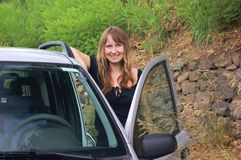 Girl in the car. Young beautiful girl in the car on the nature Stock Image