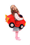 Girl and car. Girl and her  homemade toy car on the white background Royalty Free Stock Image