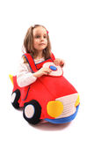 Girl and car. Girl and her homemade toy car on the white background royalty free stock images