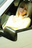 Girl in the car stock photos