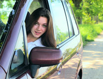 Girl  in car. Stock Images