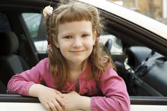 Girl in a car Stock Image