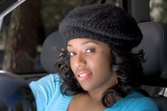 Girl in the car. Portrait of African-American in the car Royalty Free Stock Photography