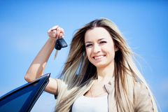 Girl with car. Beautiful girl with car key in hand Royalty Free Stock Photography