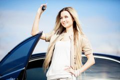 Girl with car Stock Image