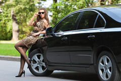 The girl in the car Royalty Free Stock Photos