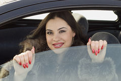 Girl in the car. Beauty woman sitting in the car Stock Images