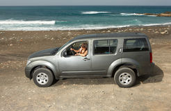 Girl and Car. Woman and her 4wd car at Fuerteventura's beach Royalty Free Stock Photos