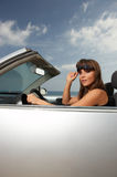 Girl and Car. Woman and her cabriolet car at Fuerteventura's beach Stock Photos