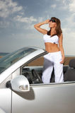 Girl and Car. Woman and her cabriolet car at Fuerteventura's beach Royalty Free Stock Photo