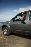Girl and Car. Woman and her 4wd car at Fuerteventura's beach Stock Photo