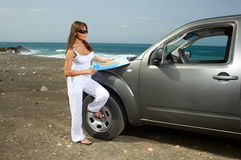 Girl and Car. Woman and her 4wd car at Fuerteventura's beach Stock Image