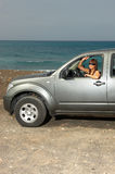 Girl and Car. Woman and her 4wd car at Fuerteventura's beach Stock Images