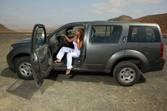 Girl and Car. Woman and her 4wd car at Fuerteventura's offroad Stock Photos