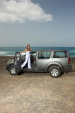 Girl and Car. Beautiful woman and her 4wd car at beach Stock Photo